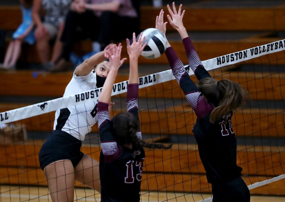 <strong>Houston senior Kennedy Shaw goes up for a spike Sept. 17 against Collierville.</strong> (Patrick Lantrip/Daily Memphian)