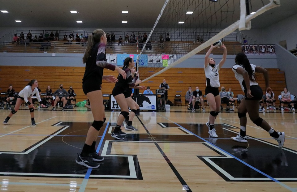 <strong>Houston senior Brooke Grant sets the ball during the Sept. 17, 2020, match against Collierville High School.</strong> (Patrick Lantrip/Daily Memphian)