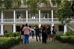 <strong>Visitors walk outside the main plantation house at the Whitney Plantation in Edgard,&nbsp;Louisiana on July 14, 2017. The Whitney, which documents slavery at a pre-Civil War plantation near New Orleans, draws tens of thousands of visitors annually and is known for discussing topics that other tourist plantations ignore. Yet even its entry in the National Register, completed in 1992 before the current owner purchased it, doesn't mention the slaves who toiled there.</strong> (AP Photo/Gerald Herbert, File)