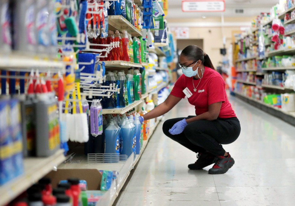 <strong>Cash Saver employee Kiara Jones stocks the shelves of the Midtown grocery store June 18, 2020.</strong> (Patrick Lantrip/Daily Memphian file)