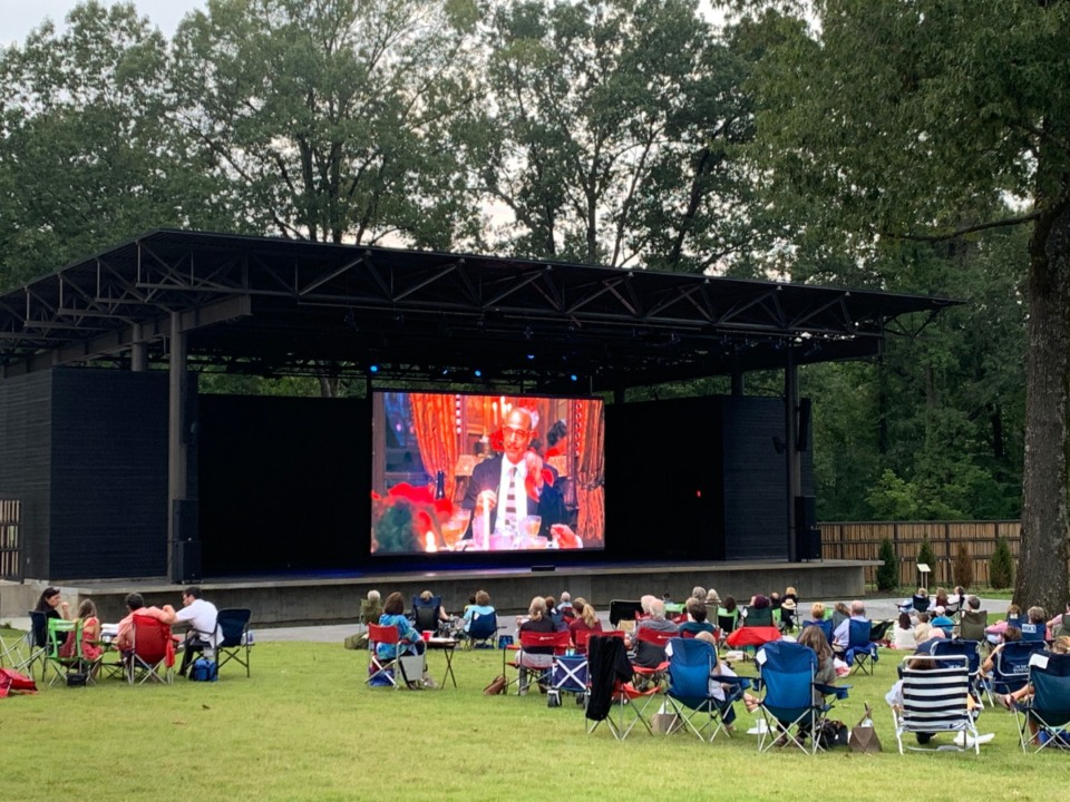 "<strong>Folks at The Grove at Germantown Performing Arts Center dine out while watching ""Julie and Julia"" on Sept. 17, the first event in a Thursday night culinary series that runs through Oct. 15.</strong> (Andrea Zucker/submitted photo)"