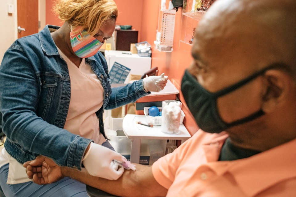 <strong>Lab technician Pam Wooten (left), conducts blood work on a patient.&nbsp;In 25 years, CCHS has grown to serve more than 56,000 patients.</strong>&nbsp;(Houston Cofield/Special to Daily Memphian)