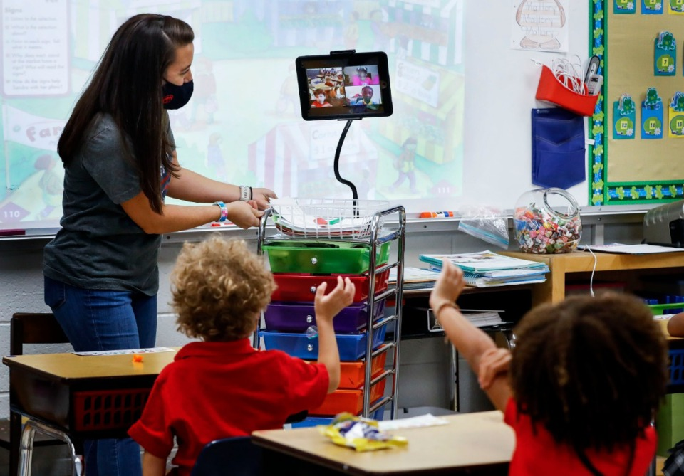 <strong>Harding Academy Lower School kindergarten students wave goodbye to their virtual learning classmates in the classroom of teacher Mallory Gatlin&nbsp;(left) Friday Sept. 18, 2020.</strong> (Mark Weber/Daily Memphian)