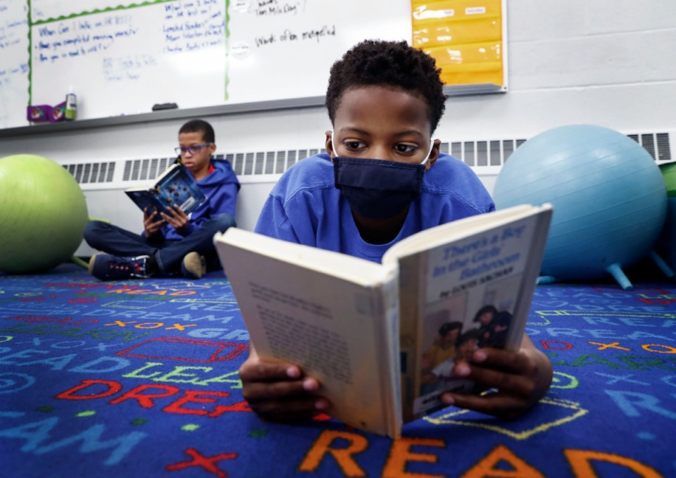 <strong>Harding Academy fifth grader Theodore Fadeyi (right) takes in a book with classmate Zachary Wakefield (left) during reading time on Friday, Sept. 18, 2020.</strong> (Mark Weber/Daily Memphian)