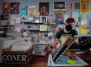 <strong>Zac Ives and Eric Friedl are the co-owners of Goner Records (where employee Cole Wheeler sorts through vinyl records and books Aug. 27, 2020) and they&rsquo;re also the organizers of GonerFest, which is going virtual this year.</strong> (Patrick Lantrip/Daily Memphian)