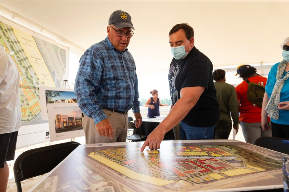 <strong>Sales agent Billy Rogers shows Michael Russell the master plan of the townhome development at Lake District in Lakeland Sunday, Sept. 20, 2020.</strong> (Ziggy Mack/Special to Daily Memphian)