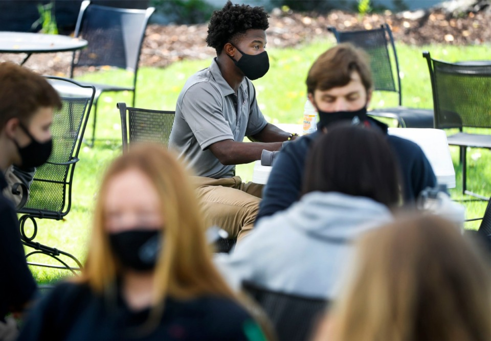 <strong>Evangelical Christian School 11th grader Jaylen Greenwood (top) attends a Junior English class under a tent in an outdoor classroom on Thursday, Sept.10, 2020.</strong> (Mark Weber/The Daily Memphian)