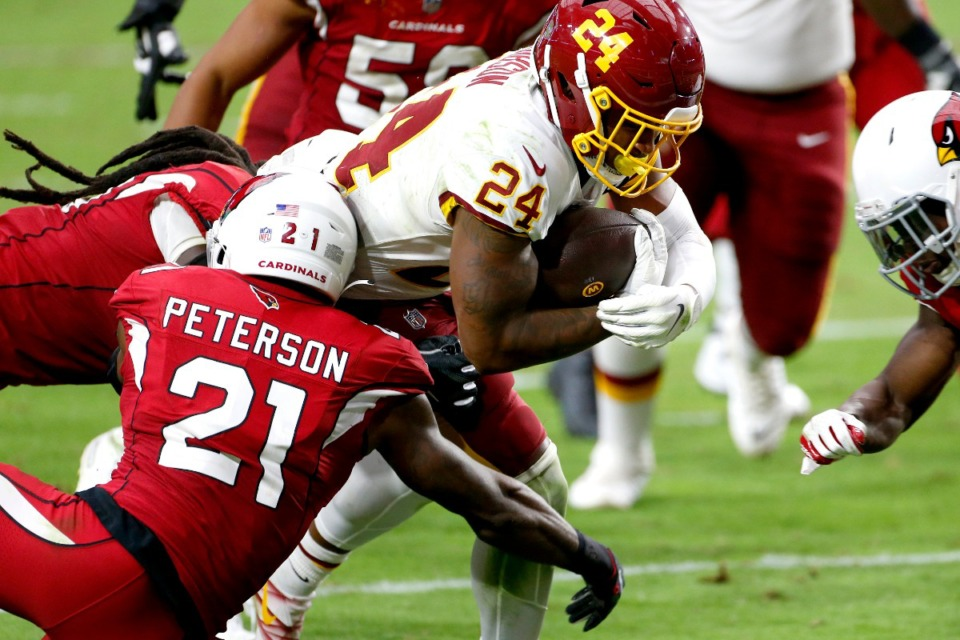 <strong>Washington Football Team running back Antonio Gibson (24) scores a touchdown as Arizona Cardinals cornerback Patrick Peterson (21) defends during the second half of an NFL football game, Sunday, Sept. 20, 2020, in Glendale, Ariz.</strong> (Darryl Webb/AP)