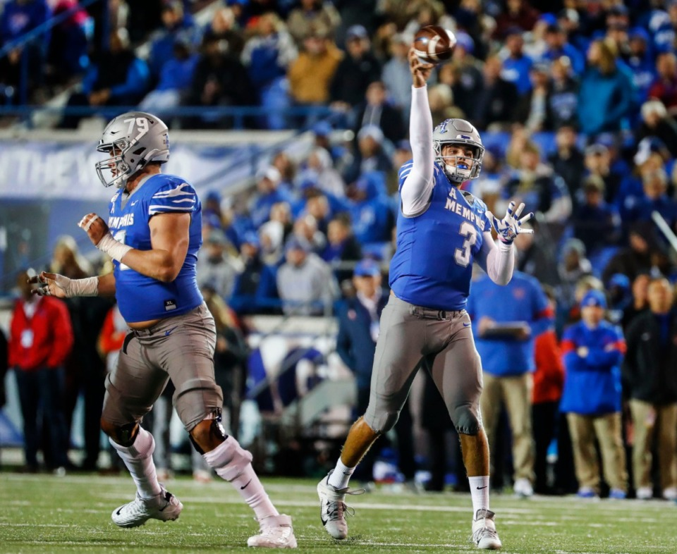 <strong>Memphis quarterback Brady White (right) makes a throw against the SMU defense during the game Saturday, Nov. 2, 2019 at Liberty Bowl Memorial Stadium.</strong> (Mark Weber/Daily Memphian file)