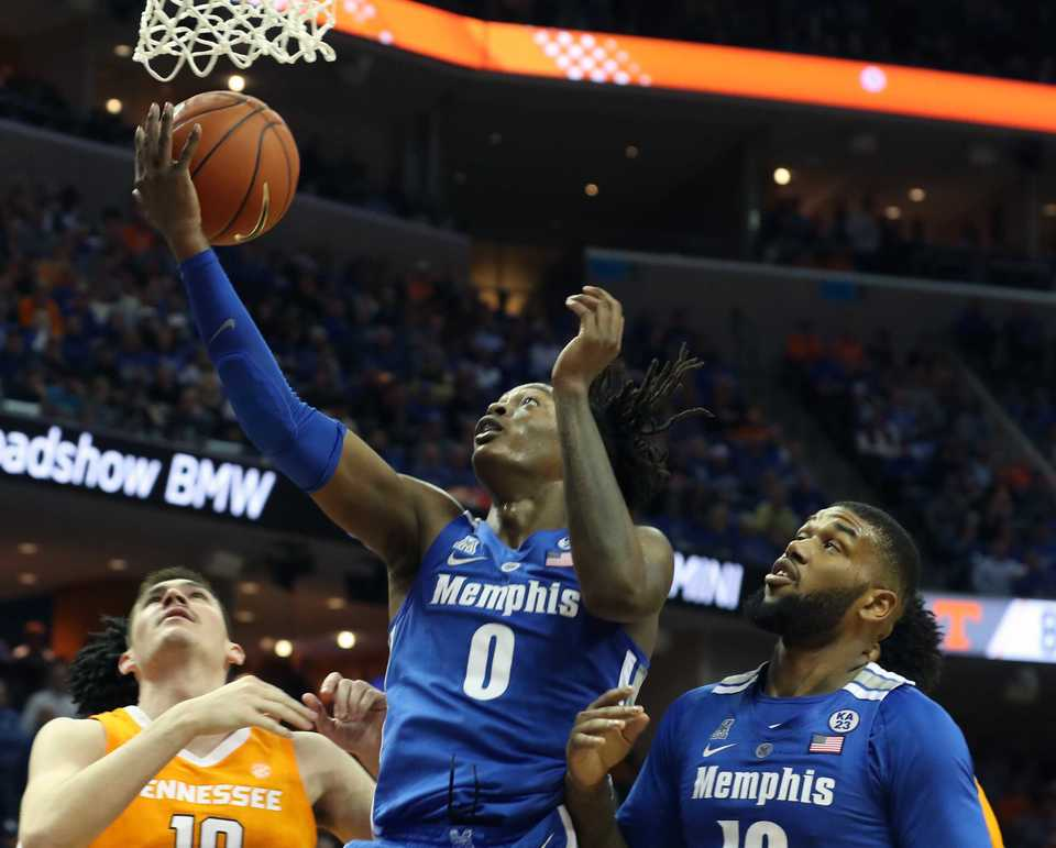 <strong>University of Memphis forward Kyvon Davenport (0) goes up for a shot as University of Tennessee forward John Fulkerson (left) comes in to block&nbsp;during the Tigers game against the Volunteers at FedExForum in Memphis on Saturday, Dec. 16, 2018.<span>&nbsp;</span></strong><span>(Karen Pulfer Focht/Special to The Daily Memphian)</span>