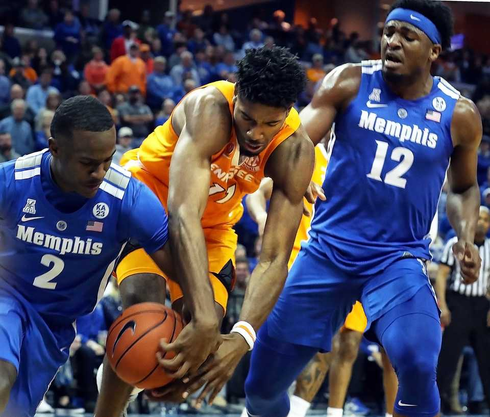 "<strong>University of Memphis guard Alex Lomax (2) tried to grab the ball from University of Tennessee forward Kyle Alexander (11)&nbsp;</strong><span class=""s1""><strong>during the Tigers game against the Volunteers at FedExForum in Memphis on Saturday, Dec. 16, 2018.</strong> (Karen Pulfer Focht/Special to The Daily Memphian)</span>"