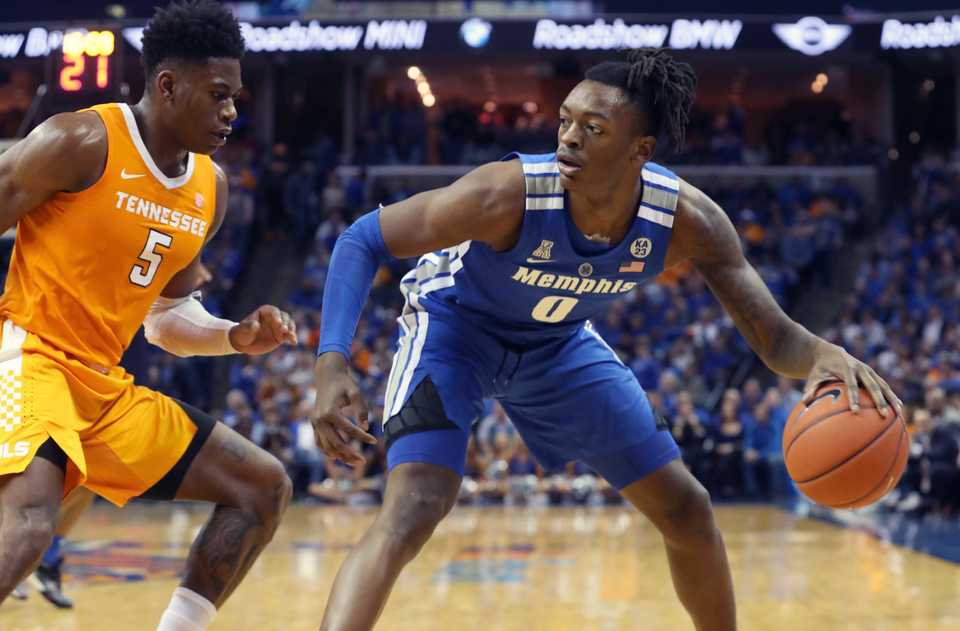 "<strong>University of Memphis forward Kyvon Davenport (0) looks for an opening while defended by University of Tennessee guard Admiral Schofield (5)&nbsp;</strong><span class=""s1""><strong>during the Tigers game against the Volunteers at FedExForum in Memphis on Saturday, Dec. 16, 2018.</strong> (Karen Pulfer Focht/Special to The Daily Memphian)</span>"