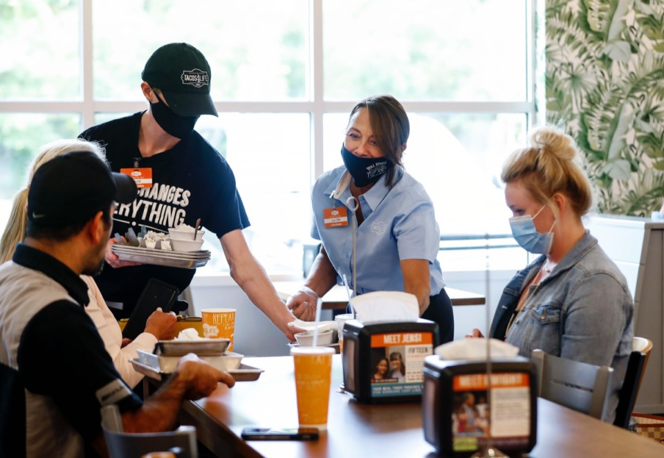 <strong>Tacos 4 Life franchisee owner Lisa Clifft (middle right) greets customers during the restaurant&rsquo;s grand opening on Tuesday, Sept. 22, in Collierville. Clifft is the Arkansas-based company&rsquo;s first female franchisee</strong>. (Mark Weber/Daily Memphian)
