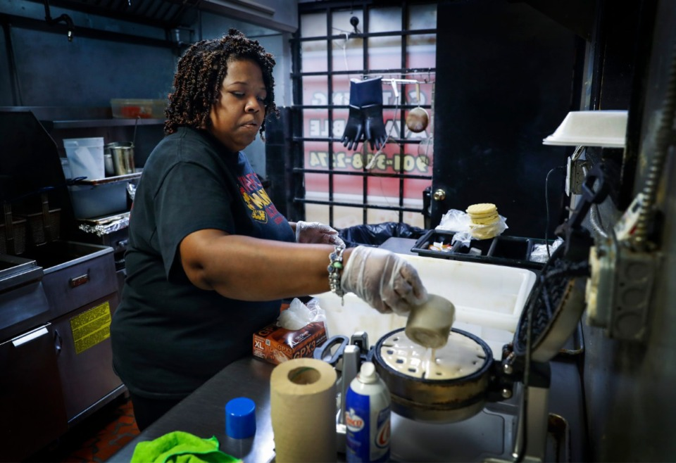 <strong>Waffle Mania co-franchisee Tarliscia Rainey (shown on March 30 preparing waffles for Shelby County Schools&rsquo; students) says the restaurant has been blessed during the pandemic. &ldquo;To be able to keep up with the flow and with the amount of people coming in and getting everything out. ... It&rsquo;s just been great,&rdquo;</strong>&nbsp;<strong>Rainey said.</strong> (Mark Weber/Daily Memphian file)