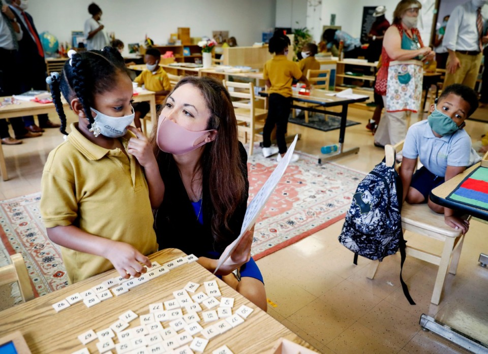 <strong>Tennessee Education Commissioner Penny Schwinn (right) visits with Shantial Harris, 6, (left) as she works to putting numbers in sequential order at Libertas School of Memphis on Sept. 1.</strong> (Mark Weber/Daily Memphian file)