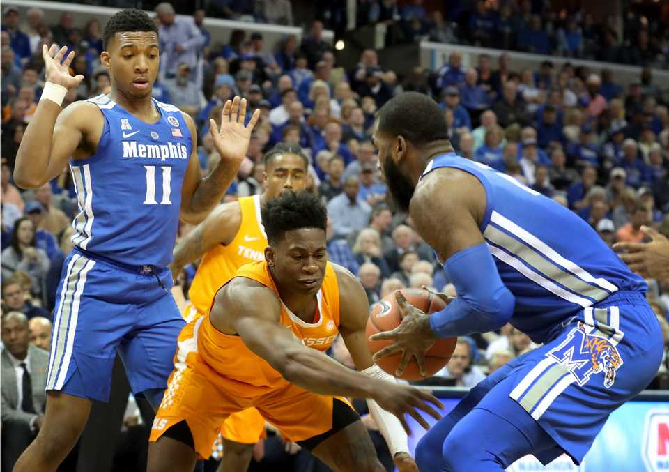 "<p class=""p1""><span class=""s1""><b>University of Memphis forward Raynere Thornton (4) and University of Tennessee guard Admiral Schofield (5) go for a loose ball&nbsp;during the Tigers game against the Volunteers at FedExForum in Memphis on Saturday, Dec. 16, 2018. </b>(Karen Pulfer Focht/Special to The Daily Memphian)</span>"