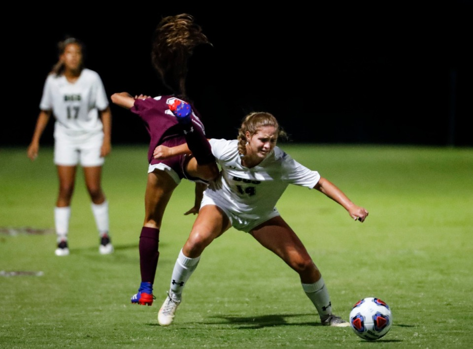 <strong>Briarcrest midfielder Alyssa Tinsley (right) takes the ball away from Collierville midfielder Morgan Smrt (left) during their soccer game on Tuesday, Sept. 22.</strong> (Mark Weber/The Daily Memphian)
