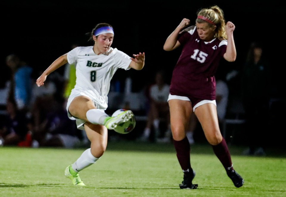 <strong>Briarcrest forward Taylor Martin (left) moves the ball around Collierville defender Abigail Myers (right) Sept. 22.</strong> (Mark Weber/The Daily Memphian)
