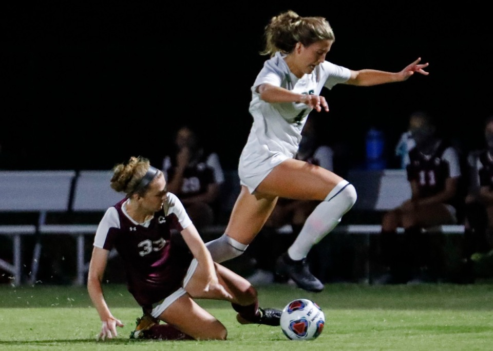 <strong>Briarcrest midfielder Sarah Strong (right) moves past Collierville midfielder Abby Johnson (left) Sept. 22.</strong> (Mark Weber/The Daily Memphian)