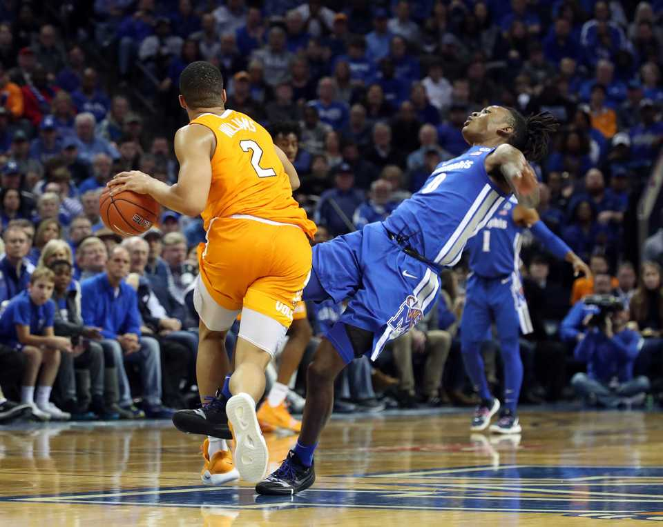 "<strong>Memphis Tigers forward Kyvon Davenport (0) falls during after being stormed by University of Tennesse forward Grant Williams (2)&nbsp;</strong><span class=""s1""><strong>during the Tigers game against the Volunteers at FedExForum in Memphis on Saturday, Dec. 16, 2018. </strong>(Karen Pulfer Focht/Special to The Daily Memphian)</span>"