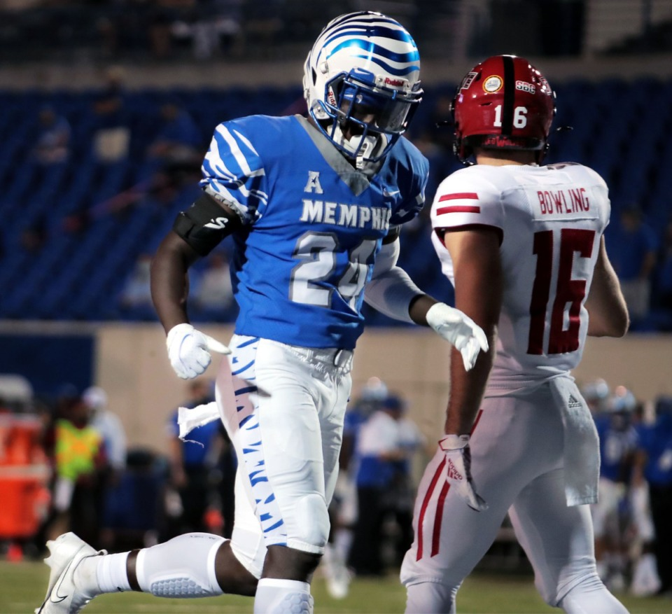 <strong>University of Memphis running back Cameron Fleming (24) jogs past an Arkansas State University defender after a play during the Tigers&rsquo; home opener at the Liberty Bowl Memorial Stadium Sept. 5, 2020.</strong> (Patrick Lantrip/Daily Mempian)