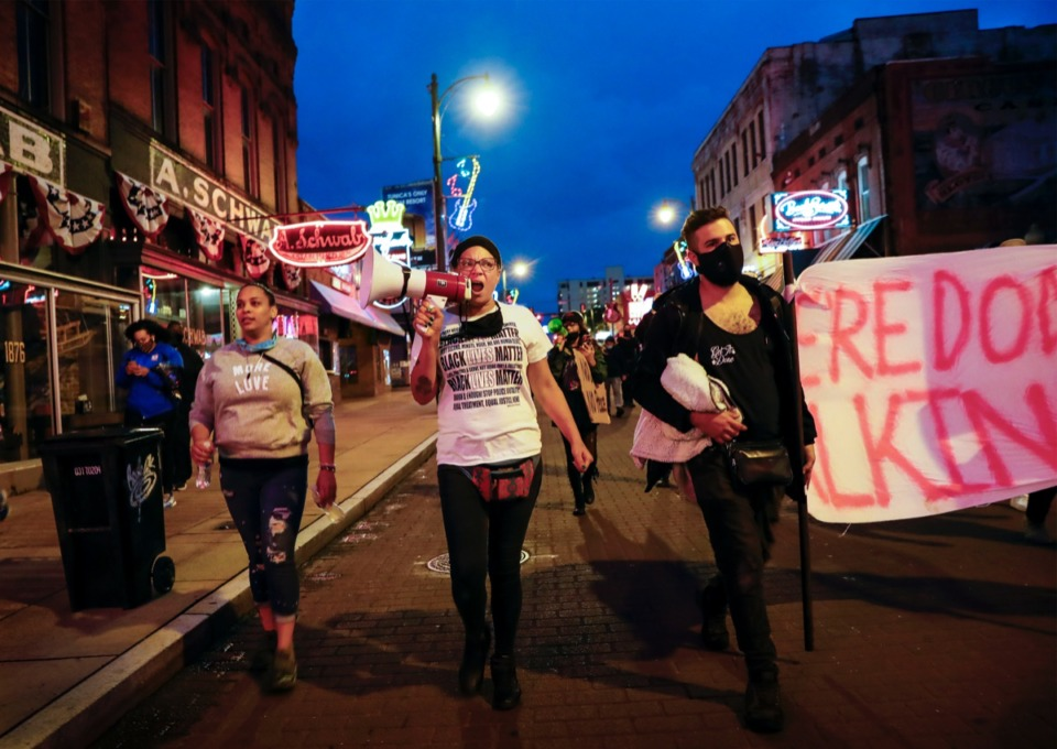 <strong>Activist LJ Abraham (middle) leads a solidarity march in honor of Breonna Taylor on Wednesday, Sept. 23, 2020, Downtown.</strong> (Mark Weber/The Daily Memphian)