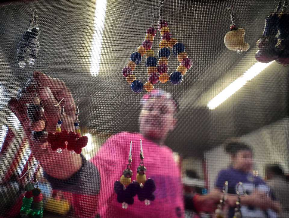 <strong>Irokei Woods, 7, displays her jewelry collection during a pop-up marketplace at Makeda's Cookies on Dec. 15, 2018 put on by members of 901 Kidpreneurs. 901 Kidpreneurs will be partnering with the new Teen Economic Advisory Committee to help young entrepreneurs earn money by using their talents.</strong> (Jim Weber/Daily Memphian)