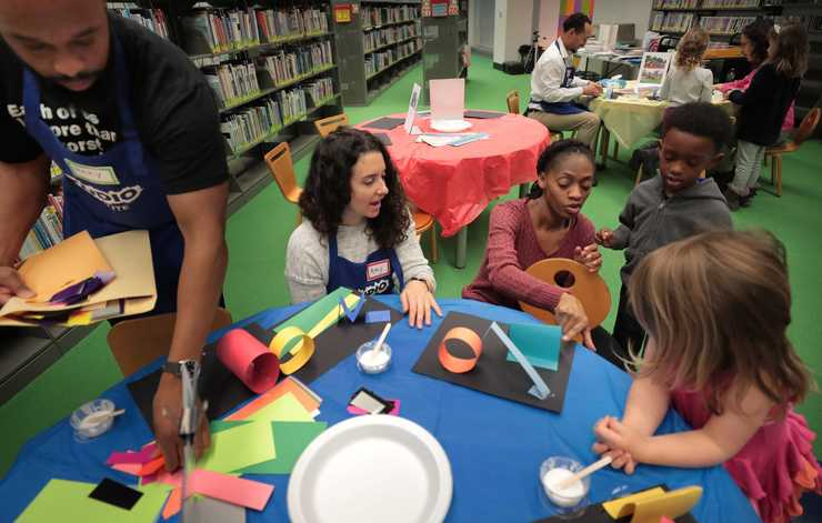 "<strong>Kids get some help from local artists while creating a 3D collage inspired by the children's book ""Over Under and Through"" during a family workshop at the Benjamin Hooks Library hosted on Dec. 15, 2018 by Studio Institute a NYC-based nonprofit which has placed artists in public school classrooms since the 70s. The Studio Institute is establishing a new program placing local artists in Shelby County preschools.</strong> (Jim Weber/Daily Memphian)"