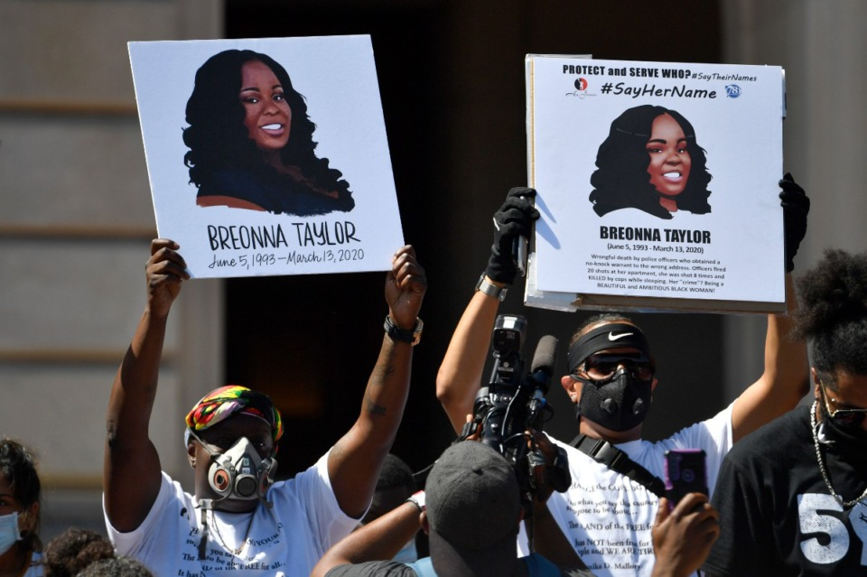 <strong>Protesters hold up signs showing Breonna Taylor during a rally in her honor on the steps of the Kentucky State Capitol in Frankfort on June 25. A grand jury on Wednesday, Sept. 23, indicted one officer on criminal charges six months after Taylor was fatally shot.</strong> (Timothy D. Easley/Associated Press file)
