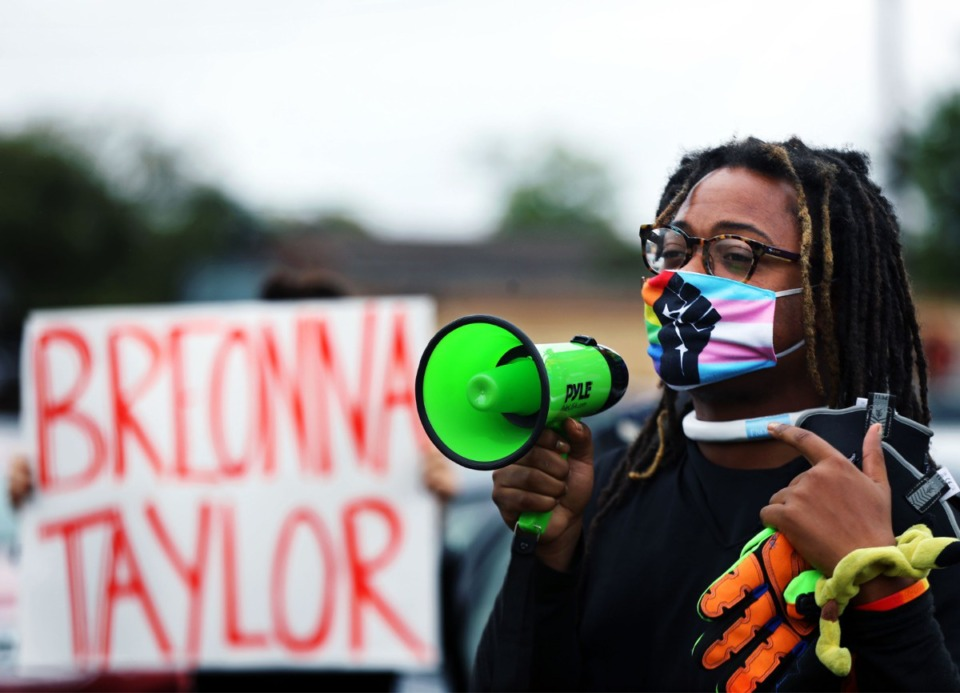 <strong>A protester chants through a megaphone outside the Shelby County Criminal Justice Center on Sept. 24.</strong> (Patrick Lantrip/Daily Memphian)