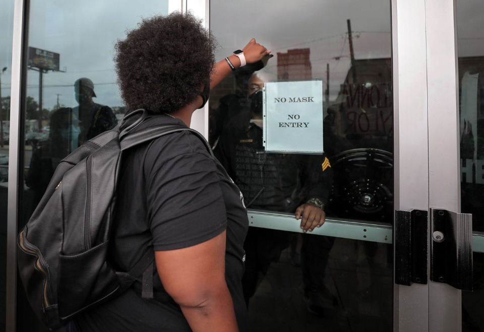 <strong>A group of Shelby County Sheriff's deputies in riot gear watch from behind locked doors as protesters gather outside the Shelby County Criminal Justice Center on Sept. 24.</strong> (Patrick Lantrip/Daily Memphian)