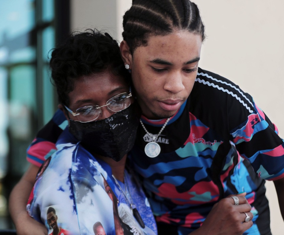 <strong>Tameka Talley hugs one of her son's friends, Jordan Butler, during a visit on Aug. 22. Talley&rsquo;s son, Jaylan Sumerall, was shot to death during a robbery in 2018. He was 19.</strong> (Patrick Lantrip/Daily Memphian)