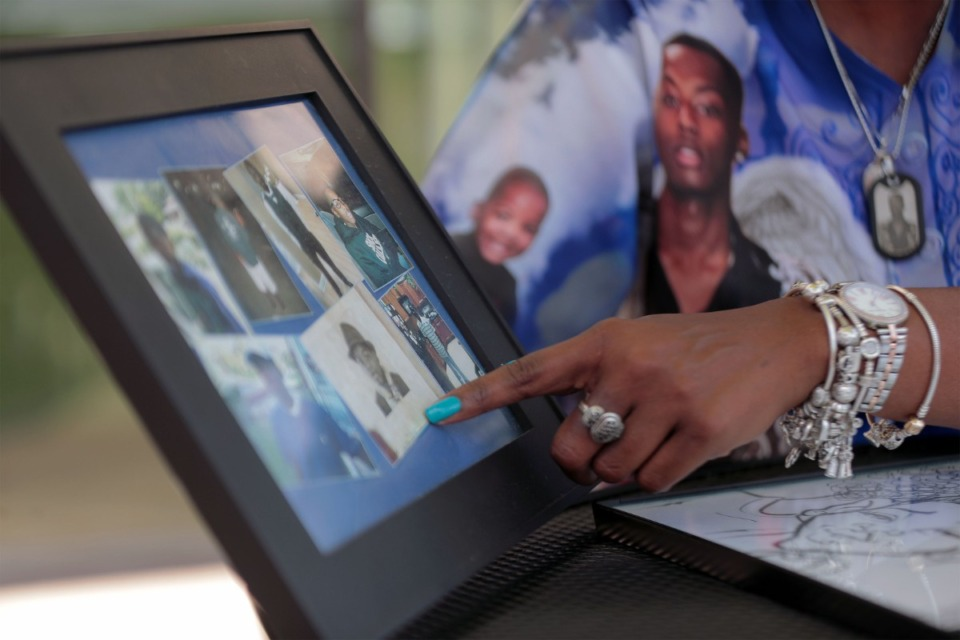 <strong>Tameka Talley shows framed baby pictures of her son, Jaylan Sumerall,&nbsp; who was slain in 2018 during a botched robbery.</strong> (Patrick Lantrip/Daily Memphian)