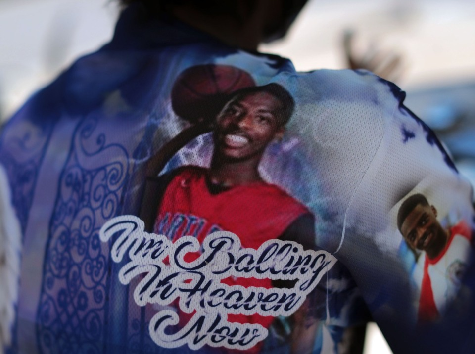 <strong>Tameka Talley wears a shirt with pictures of her son on it. Jaylan Sumerall was killed in 2018.</strong> (Patrick Lantrip/Daily Memphian)