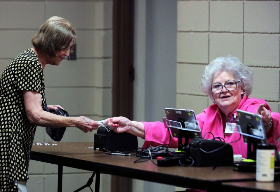 <strong>Jane Fennell directs an early voter where to go next at the White Station Church of Christ polling location in East Memphis Sept. 20, 2019.</strong> (Patrick Lantrip/Daily Memphian file)