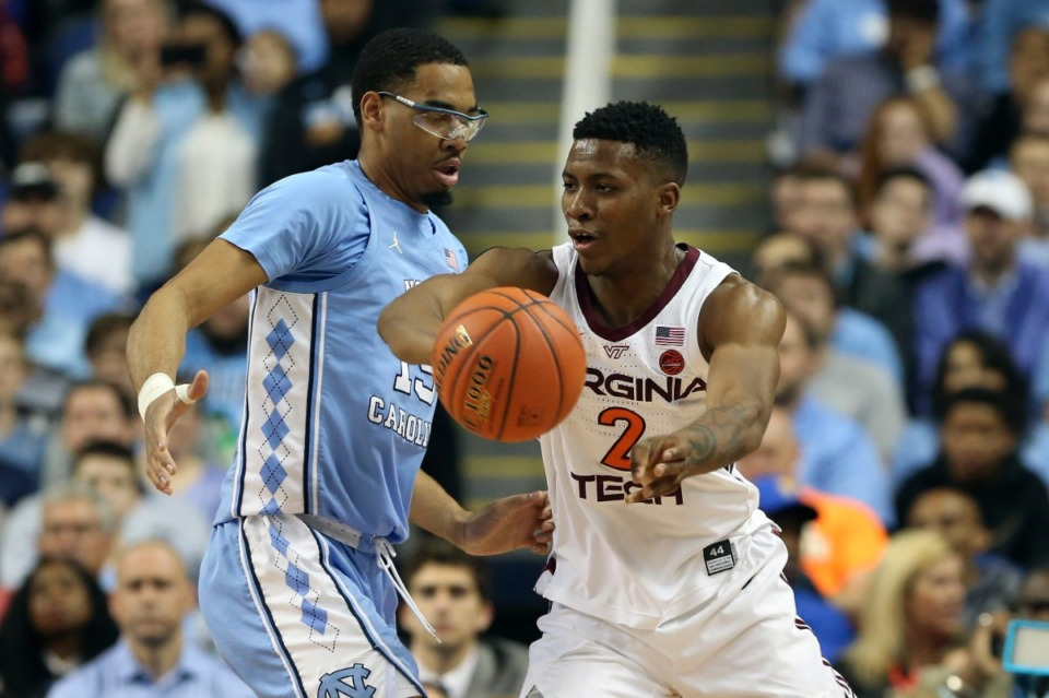 <strong>Landers Nolley II (2) wore a Virginia Tech uniform on March 10, 2020, when he dodged North Carolina forward Garrison Brooks (15) at the Atlantic Coast Conference tournament in Greensboro, N.C.</strong> (Ben McKeown/AP file)