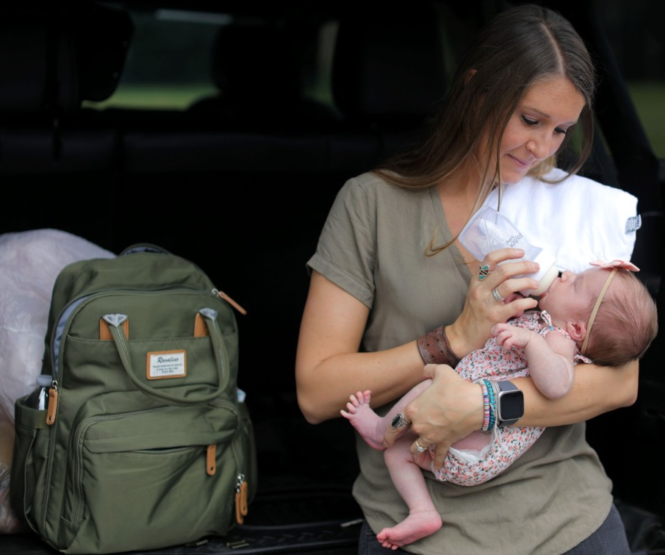 <strong>Madison Thomas feeds her daughter, Palmer, before heading back to her home in Somerville from doctor's visit at Memphis Obsterisics and Gynecological Associates in Bartlett Sept. 16, 2020.</strong> (Patrick Lantrip/Daily Memphian)
