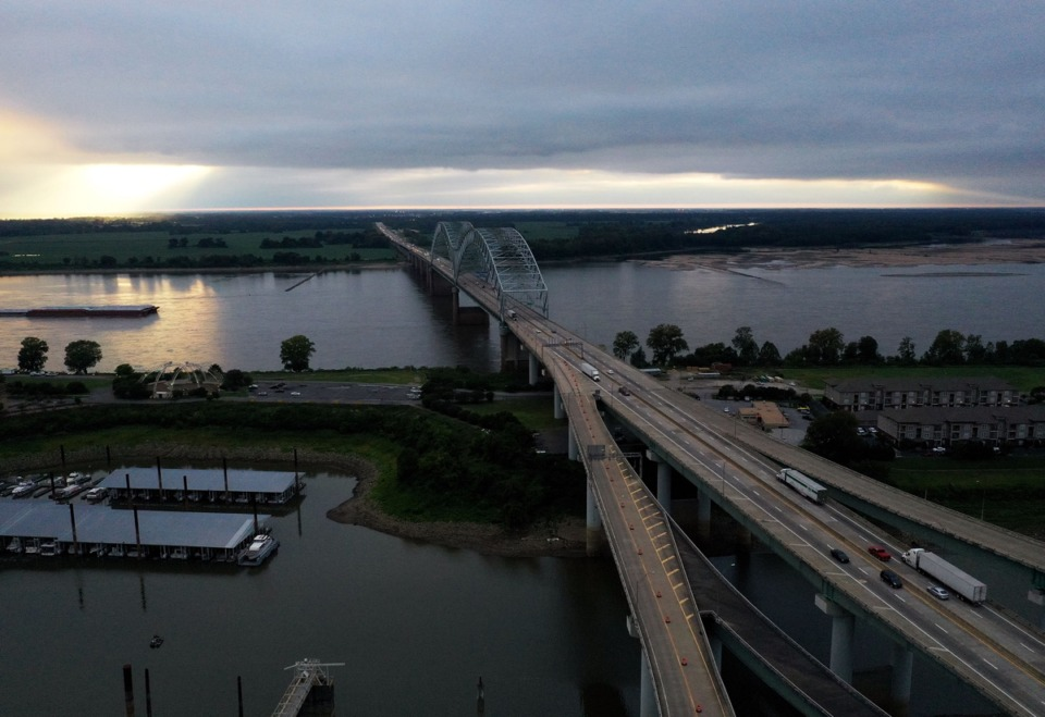 <strong>Cars and trucks zip across the Mississippi River along Interstate 40 Sept. 25, 2020. Memphis currently ranks second among cities whose residents are talking long road trips.</strong> (Patrick Lantrip/Daily Memphian)