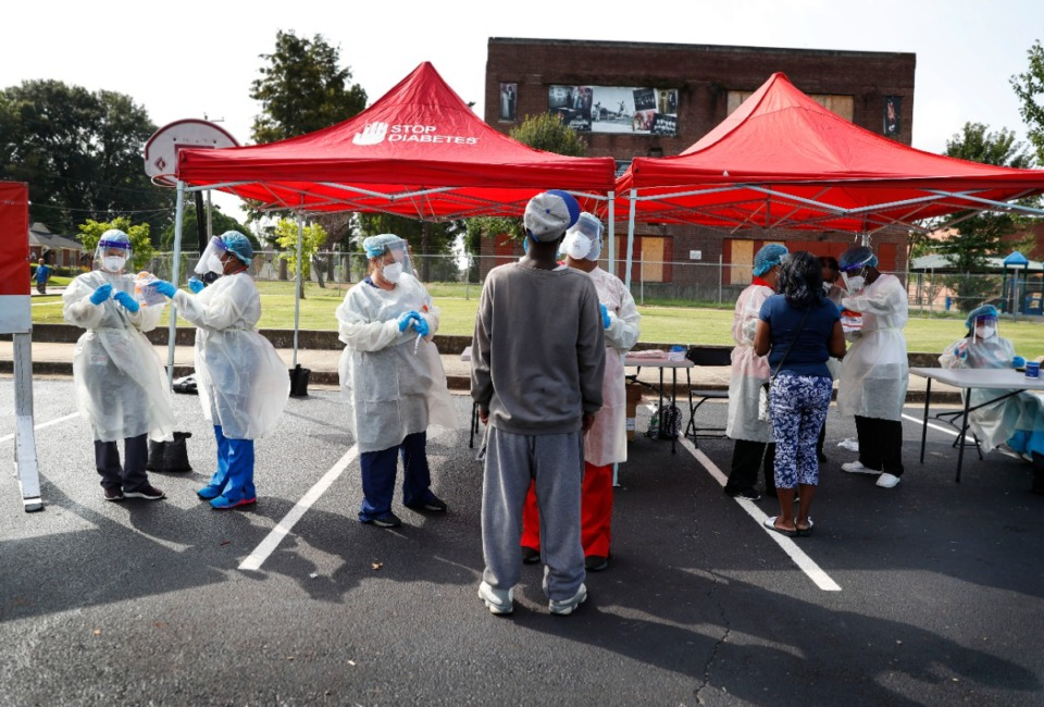 <strong>Christ Community Health Services staff members collect nasal swabs during a walk-up coronavirus testing on September 17, 2020, at Orange Mound Health Center.</strong> (Mark Weber/The Daily Memphian)