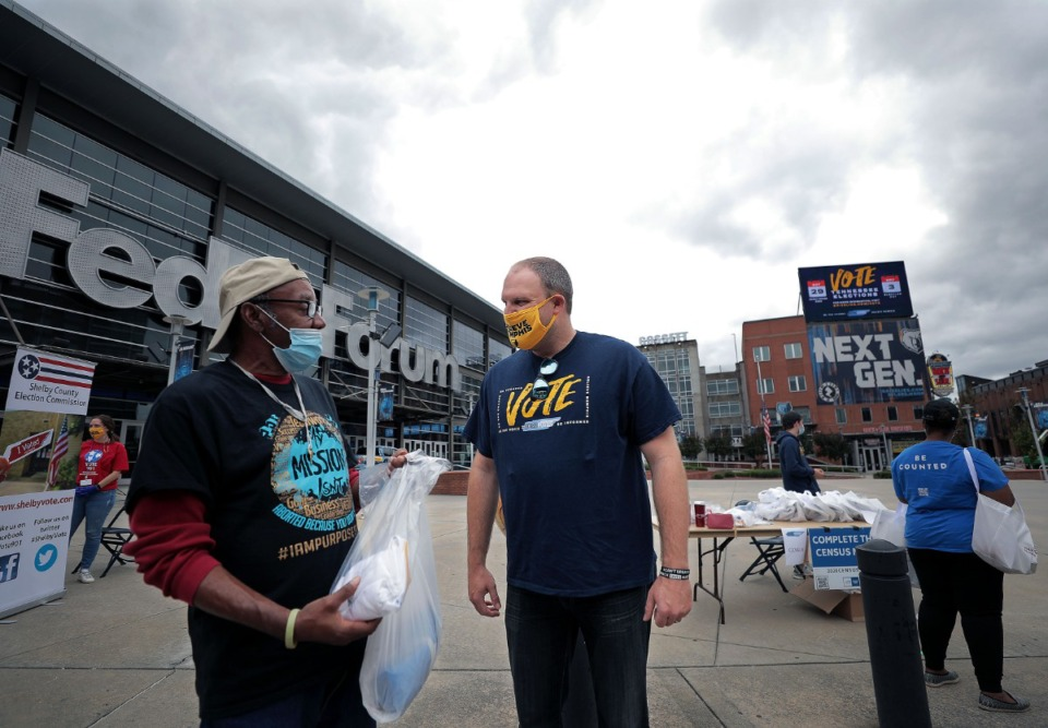 <strong>Memphis Grizzlies head coach Taylor Jenkins talks with newly registered voter Charles Foster outside of the FedExForum Sept. 26, 2020.</strong> (Patrick Lantrip/Daily Memphian)