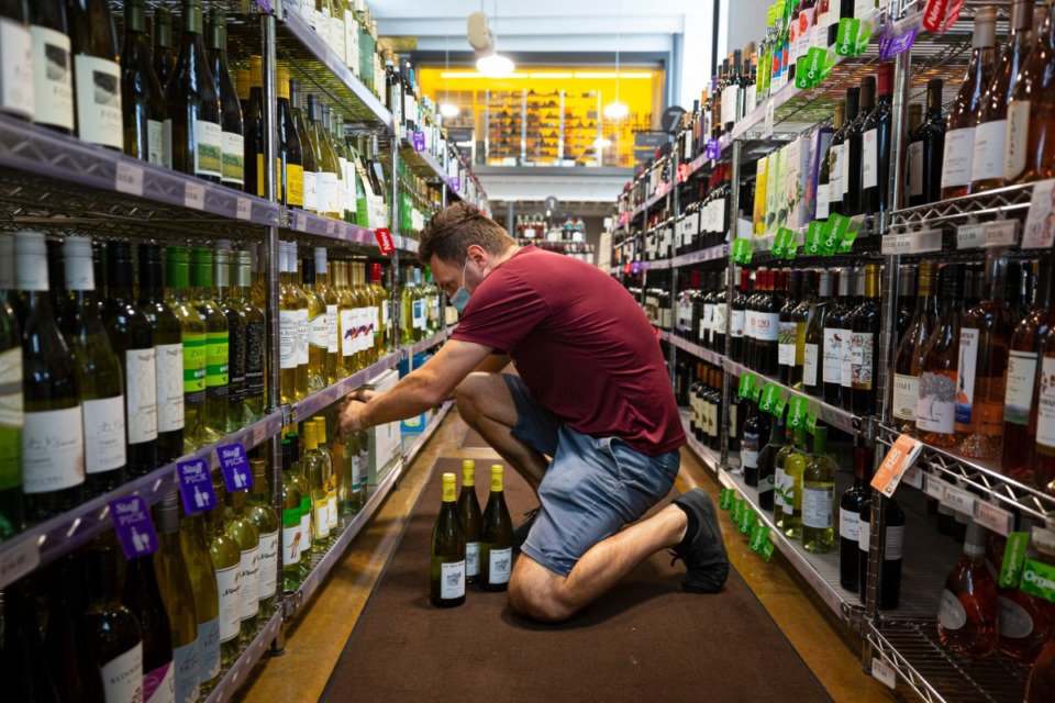 <strong>Stores such as Kirby Wines &amp; Liquor in East Memphis, where employee Nermin Houdzic stocks wine and spirits on Friday, Sept. 25, 2020, have been busy since March.</strong> (Ziggy Mack/Special to Daily Memphian)