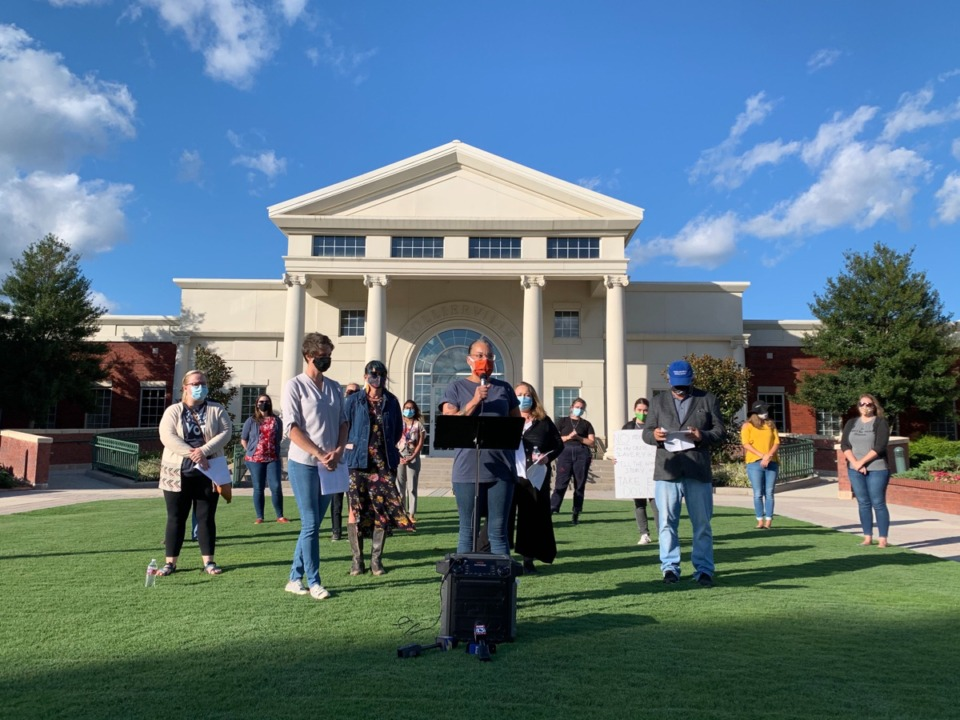 <strong>Activist LJ Abraham (center, orange mask) was among those who spoke at a press conference about the Confederate monument in Town Square Park before Collierville&rsquo;s Board of Mayor and Aldermen meeting Monday.&nbsp;</strong>(Abigail Warren/Daily Memphian)