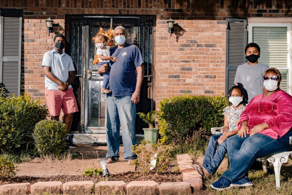 <strong>Brenda Nichols (right) prayerfully annointed the front door of the Bartlett home she shares with her husband Reginold Nichols (third from left) with oil, to protect all who enter from illness. They help care for grandchildren (from left) Eddie Houston, Carter Nichols, Reaghan Nichols and Royce Harper, whose parents are front-line workers.&nbsp;</strong>(Houston Cofield/Special to Daily Memphian)