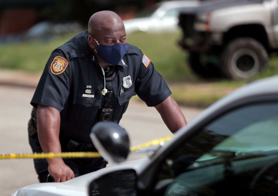 <strong>Memphis Police Officer B. Johnson stares off into the distance while responding to a homicide call in North Memphis Sept. 17, 2020</strong>. (Patrick Lantrip/Daily Memphian)