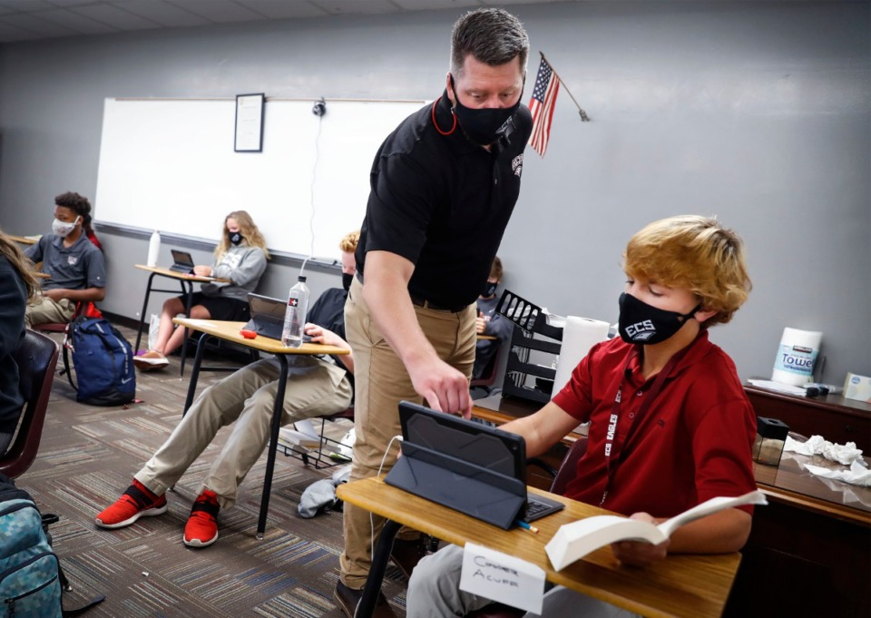 <strong>Evangelical Christian School Literature teacher Andy Gross (left) works with eight grade student Cooper Acuff (right) on Thursday, Sept.10, 2020.</strong> (Mark Weber/The Daily Memphian)