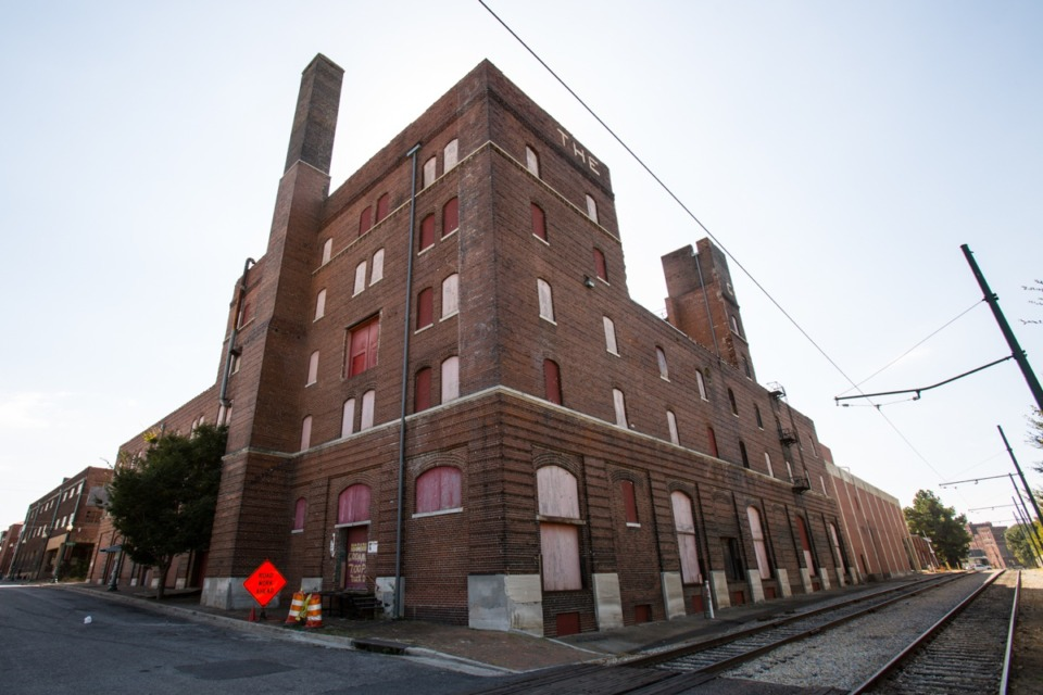 <strong>A plan to redevelop the historic Nylon Net Building site for apartments now calls for the entire building, including smokestack, to be demolished.</strong> (Daily Memphian file)
