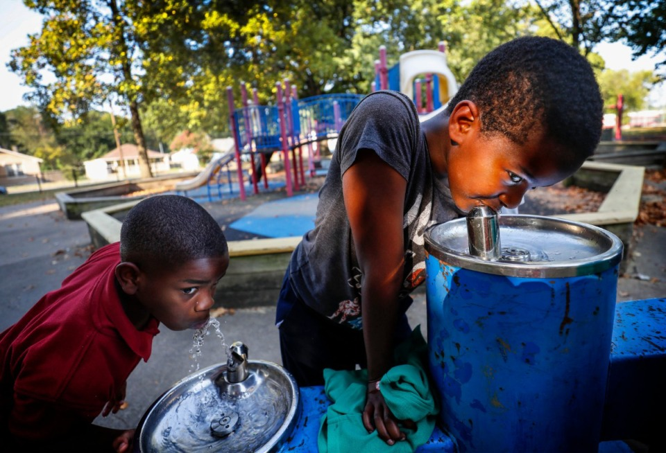 <strong>Taggart Blackmon, 7 (left), and Mubaric Balcha, 10, (right) get a drink of water after playing in Binghampton Park Tuesday, Sept. 10, 2019.</strong> (Mark Weber/Daily Memphian)