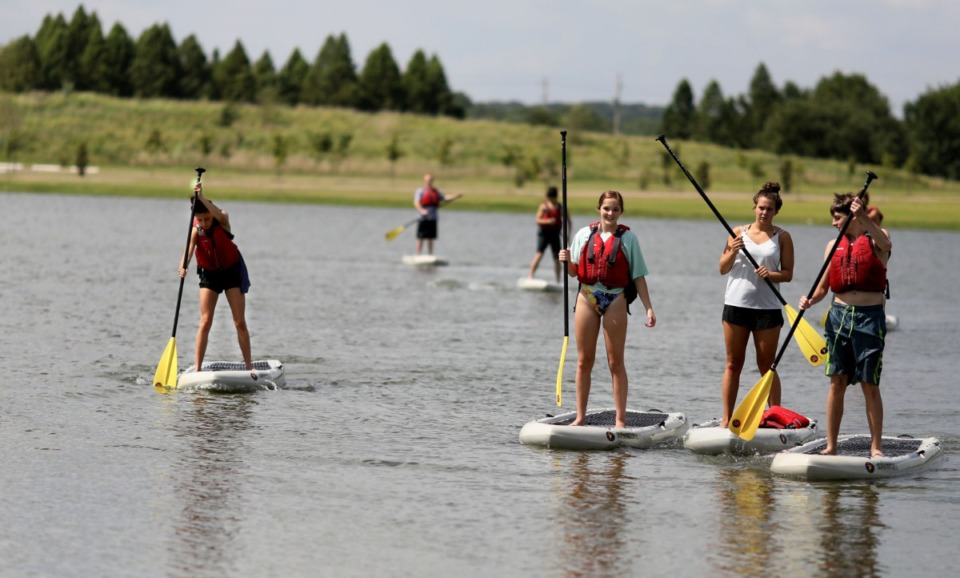 <strong>Shelby Farms visitors paddle board on Hyde Lake.&nbsp;Shelby Farms is one of many outdoor spaces included in the new memphisadventures.com. </strong>(Patrick Lantrip/Daily Memphian file)