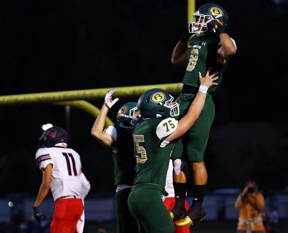 <strong>Briarcrest Christian School receiver Jerrod Gentry (8) gets hoisted up by teammates after scoring the opening touchdown during a home game against St. Benedict at Auburndale Sept. 18, 2020.</strong> (Patrick Lantrip/Daily Memphian)