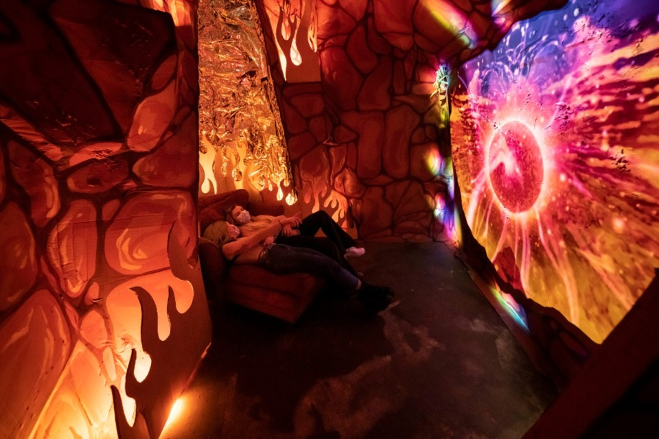 <strong>Two explorers find a secret nook, for a trippy place to lounge within&nbsp;&ldquo;BVOE&rdquo;'s Volcano Moon.</strong>&nbsp;(Courtesy Christopher Reyes)